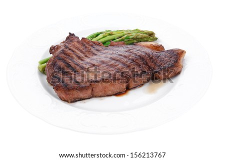 meat table : rare medium roast beef fillet asparagus served on white plate  isolated over white - stock photo