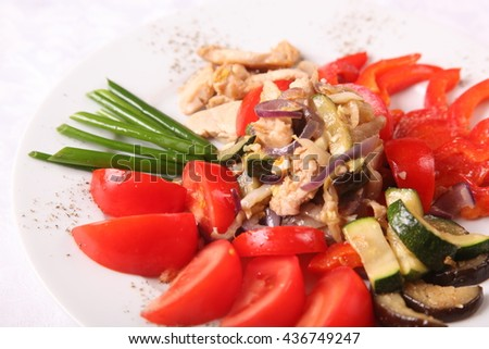 meat with garnish of red tomatoes - stock photo