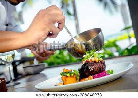 Meat with potatoes and asparagus on a white plate. The Restaurant - stock photo