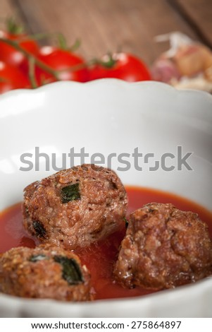 Meatball in tomato sauce - close up - stock photo