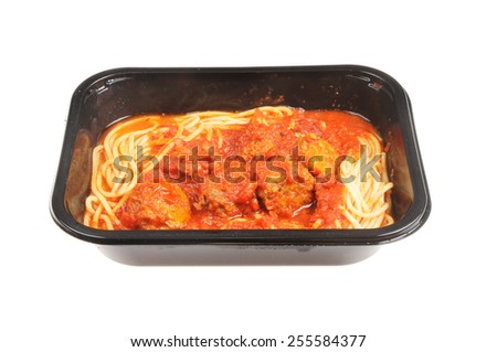 meatballs and spaghetti in a plastic carton isolated against white - stock photo