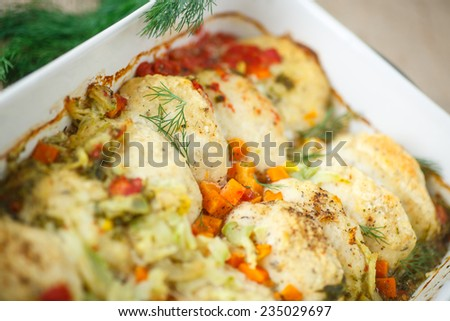 meatballs fish with vegetable sauce in baking dish - stock photo