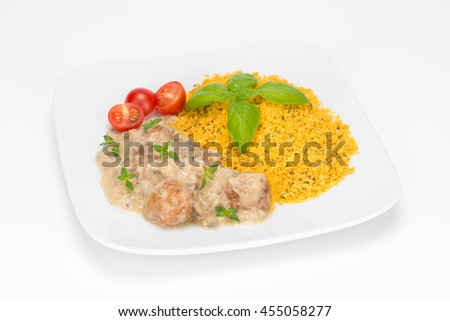 meatballs in mushroom sauce with cous cous groats on the plate isolated on white background - stock photo