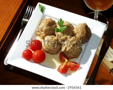 meatballs in onion sauce whit cherry tomatoes - stock photo