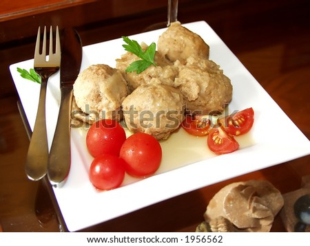 meatballs in onions sauce whit cherry tomatoes - stock photo