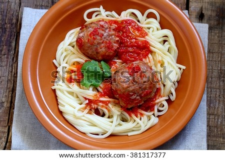 Meatballs in tomato sauce with hot pepper and a spaghetti