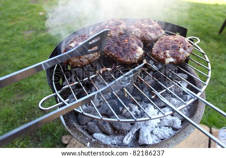 meatballs on smoking grill in the garden - stock photo