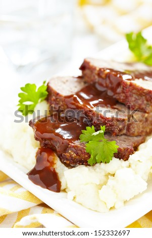 Meatloaf with brown sauce on mashed potato - stock photo