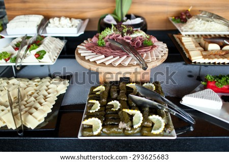 Meats and cheese buffet on hotel breakfast - stock photo
