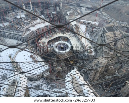 MECCA-DEC.21:Top view construction cranes in the background of Masjid Al Haram on Dis 21, 2014 in Mecca. Mecca currently in the process of expansion to cater for more pilgrims - stock photo
