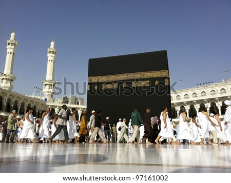 MECCA - FEB. 20 : A close up view of Muslim pilgrims circumambulate the Kaaba from ground floor of Haram Mosque Feb. 20, 2012 in Mecca. Muslims all around the world face the Kaaba during prayer time. - stock photo