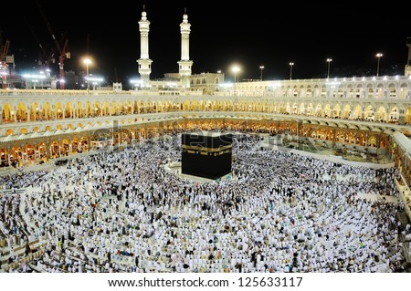 MECCA - JULY 21 : A crowd of pilgrims circumabulate (tawaf) Kaaba on July 21, 2012 in Mecca, Saudi Arabia. Pilgrims circumambulate the Kaaba seven times in counterclockwise direction. - stock photo