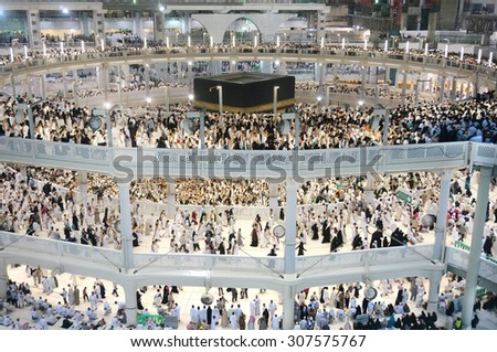 MECCA - JULY 04 : Crowd of pilgrims circumambulate around Kaaba on July 04, 2015 in Mecca,Saudi Arabia. Pilgrims circumambulate seven times to show their submission to the religion.  - stock photo