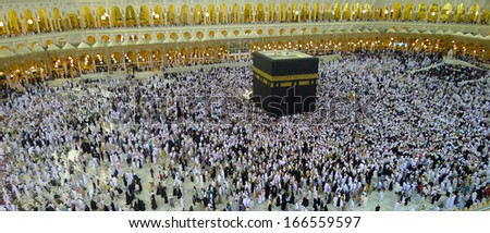 MECCA - JULY 6 : Crowd of pilgrims waiting for azan for isya praying in front Kaaba on July 6, 2011 in Mecca,Saudi Arabia. Pilgrims prays five times per day to show their submission to the religion. - stock photo