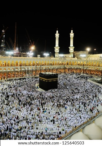 MECCA - JULY 21 : Pilgrims inside the Kaaba on July 21, 2012 in Mecca, Saudi Arabia.  Kaaba in Mecca is the holiest and most visited mosque for all Muslims. - stock photo