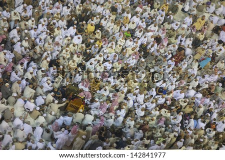 MECCA ,S.ARABIA-JUN 6:Muslim men listen to sermon delivered by local imam in Makkah on June 7, 2013.The sermons normally involve questions and answer and discussion on issues which related to Muslims. - stock photo
