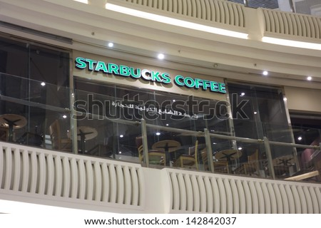 MECCA ,S.ARABIA-JUN 7:Starbucks coffee outlet at Abraj Al Bait shopping complex in Makkah June 7, 2013.The government faces criticism due to its recent opening of the outlet at Islam's holiest city - stock photo