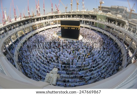 MECCA, SAUDI ARABIA-CIRCA DEC 2014:Muslims in ready for praying facing the Kaaba at Masjidil Haram in Makkah, Saudi Arabia. Muslims all around the world face the Kaaba during prayer time. - stock photo