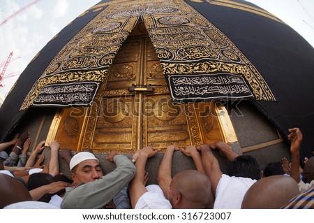 MECCA, SAUDI ARABIA-CIRCA MAY 2015: A close up view of Kaaba door at Masjidil Haram on MAY, 2015 in Makkah, Saudi Arabia. The door is made of pure gold. - stock photo