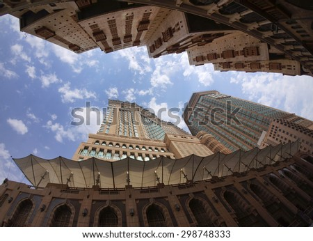 MECCA, SAUDI ARABIA-CIRCA MAY 2015: Lower view of Minarets and building around Makkah holy mosque on MAY, 2015 in Makkah, Saudi Arabia. - stock photo