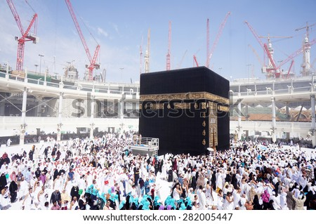 MECCA, SAUDI ARABIA-CIRCA MAY 2015: Muslims are doing tawaf around the Kaaba in Masjidil Haram in Makkah, Saudi Arabia. The mosque is under construction to expand the space for hajj - stock photo