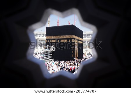 MECCA, SAUDI ARABIA-CIRCA MAY 2015: Muslims are doing tawaf around the Kaaba in Masjidil Haram on MAY, 2015 in Makkah, Saudi Arabia. Muslims all around the world come here doing umrah and hajj - stock photo