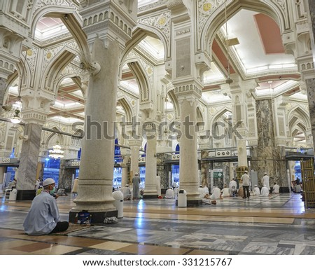 MECCA, SAUDI ARABIA-CIRCA OCT 14, 2014: A view of pilgrims resting at Masjidil Haram on Oct 14, 2014 in Makkah, Saudi Arabia. Muslims all around the world face the Kaaba during prayer time. - stock photo