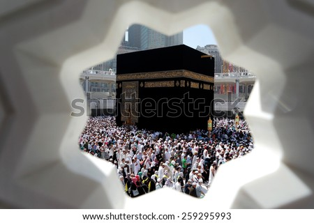 MECCA, SAUDI ARABIA - FEBRUARY 4: Muslim pilgrims, from all around the World, revolving around the Kaaba on February 4, 2015 in Mecca, Saudi Arabia. Muslim people praying together at holy place. - stock photo