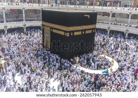 MECCA, SAUDI ARABIA-MAC 09, 2015: WIde angle view of Muslim pilgrims circumambulate the Kaaba counter-clockwise at Masjidil Haram in Makkah, Saudi Arabia.  - stock photo