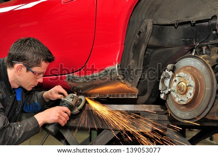 Mechanic at work. - stock photo