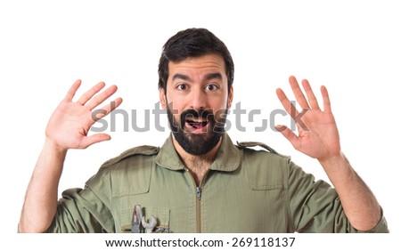 Mechanic doing surprise gesture  - stock photo