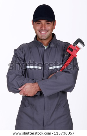 mechanic holding a spanner - stock photo