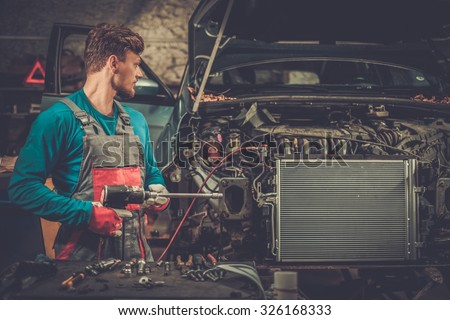 Mechanic in a workshop - stock photo