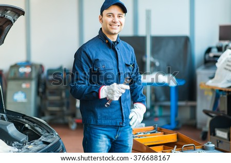 Mechanic in his workshop - stock photo
