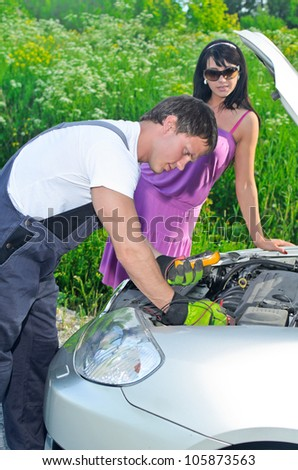 Mechanic measures lead - stock photo