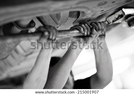 Mechanic men hands working in team. Black and white - stock photo
