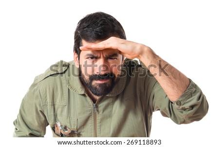 Mechanic showing something over white background  - stock photo