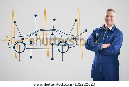 Mechanic standing in front of a background with car and heart line - stock photo