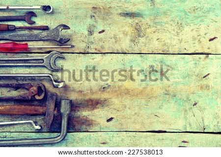 Mechanic tools set on a wooden background  - stock photo