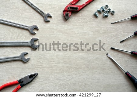 Mechanic tools with wooden background. Top view with copy space - stock photo