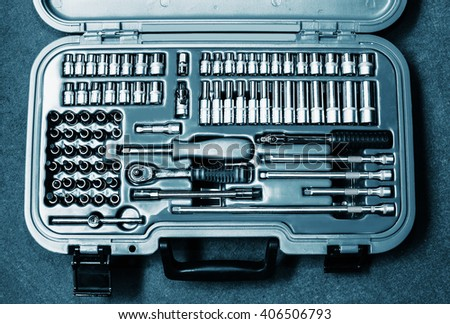 Mechanic trunk full of tools and keys, technical blue colored - stock photo