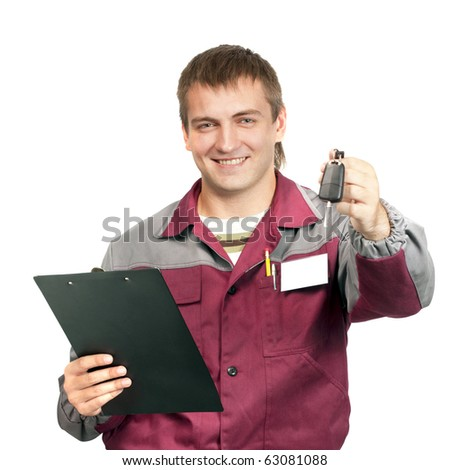 Mechanic with clipboard giving a car key. Isolated on white - stock photo