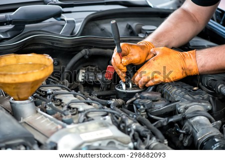 Mechanic working on a diesel filter, close up - stock photo