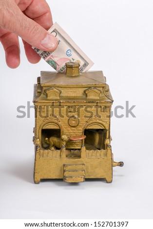 Mechanical Bank & Dollar - stock photo