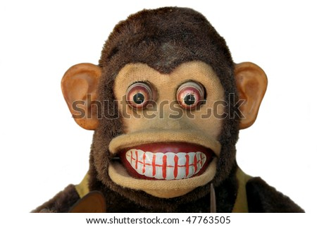 Mechanical monkey toy, close-up of face with teeth showing - stock photo