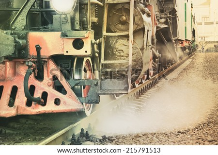 Mechanical part of steam locomotive before departure. Vintage image. - stock photo