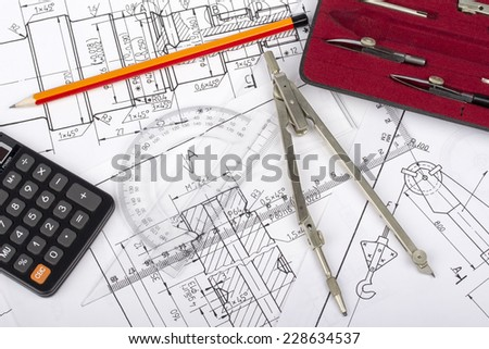 Mechanical parts drawing by designer with technical drawing tools on blueprint backgrounds - stock photo