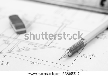 Mechanical pencil and eraser on construction plan, technical drawing - stock photo
