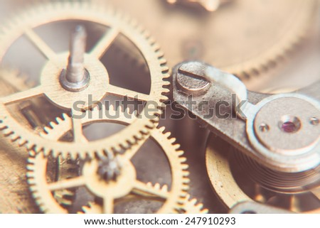 Mechanical watches mechanism very close up, blurred background for design - stock photo