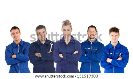 Mechanics in boiler suits portrait on white background - stock photo